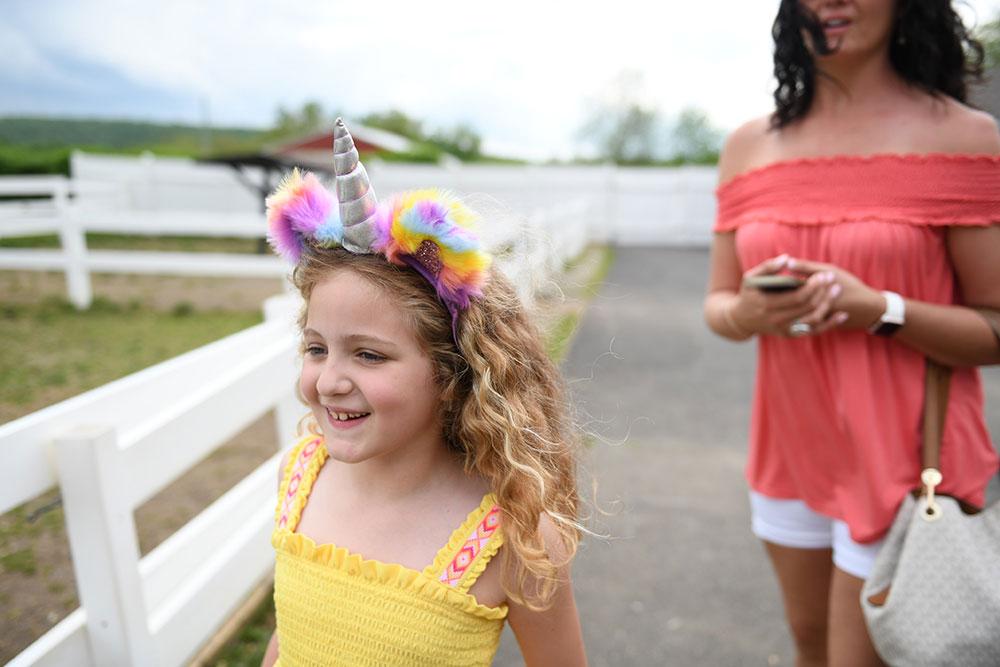Young Smiling Girl Wearing Unicorn Headband