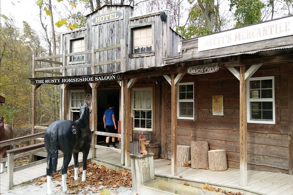 Rusty Horsehoe Saloon in Western Town at Land of Little Horses Animal Theme Park